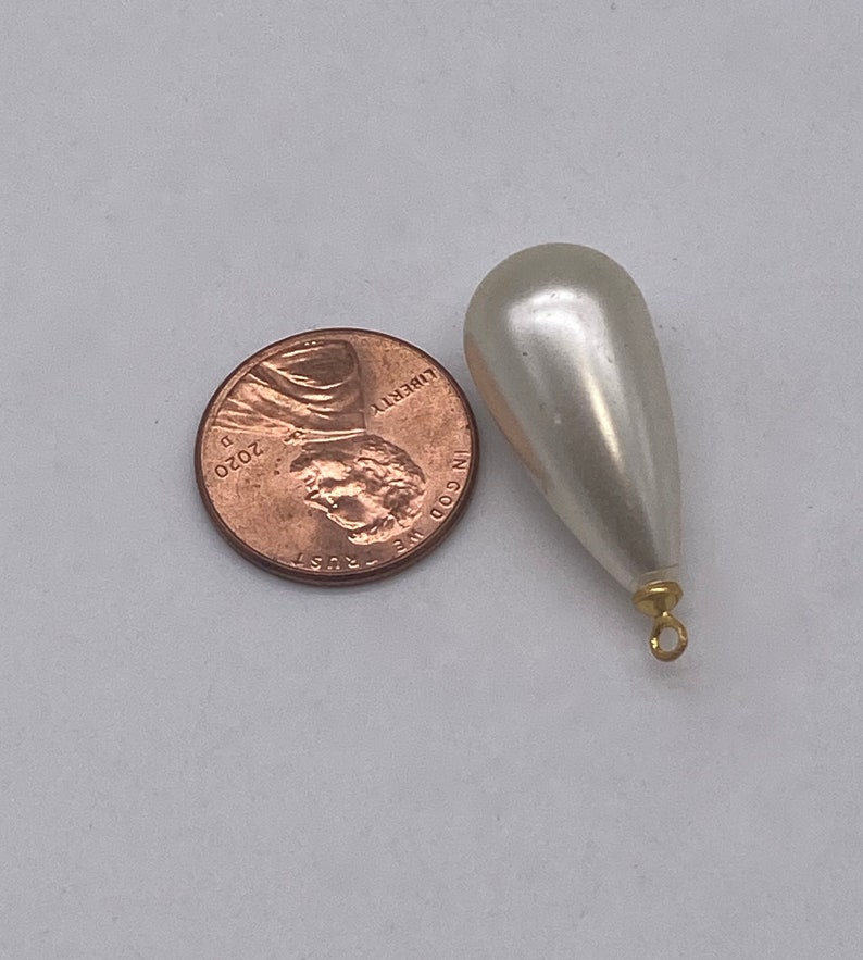 Large Pearly teardrops with gold plated eye pin. 12 pieces per price