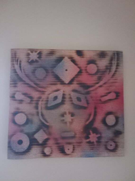 Handmade wall art for anyone who's likes weird street art. Hand cut burnt and painted by a local artist. One if a kind.