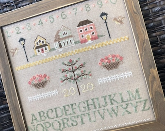 Peachtree Park Cross Stitch Sampler - Instant Download PDF chart, featuring soft shades of sage green, peach, and yellow