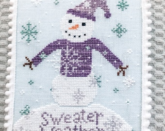 Sweater Weather Winter Cross Stitch Pattern PDF Chart with pretty snowflakes and a cute snowman in a purple sweater
