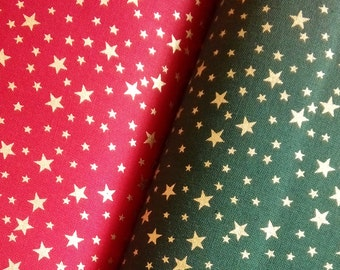fat quarter cotton with small metallic gold//silver stars on green or red