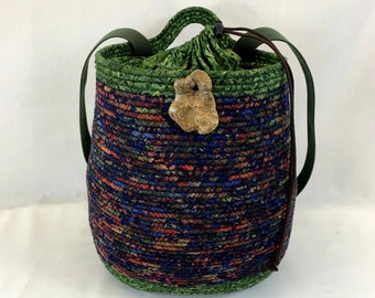 Oval backpack in blue and green with top closure, day hike backpack, hiking backpack, coiled basket, rope basket, clothesline basket