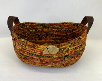 Medium oval Fall colored coiled fabric basket with handles, coiled basket, rope basket, clothesline basket, mask basket, remote controls