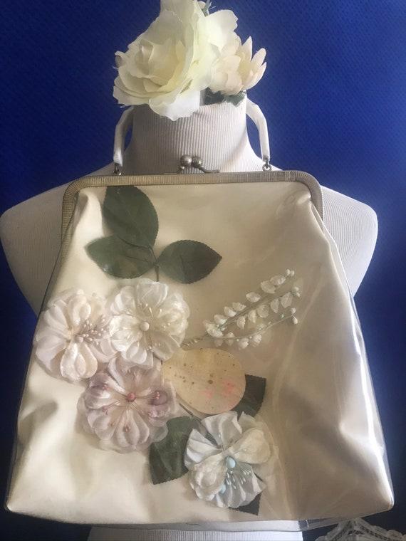 1950s clear vinyl covered handbag with silk flower