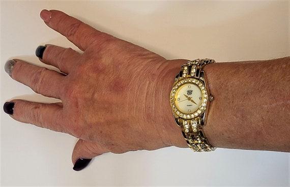 Elizabeth Taylor White Diamonds Watch - Gold Tone