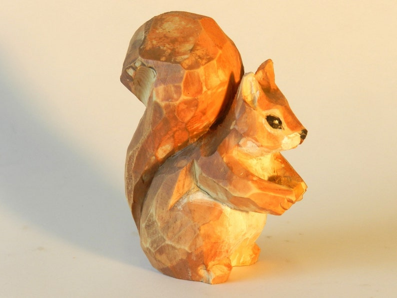 Sitting squirrel with acorn made of cirmolo wood carved and image 0