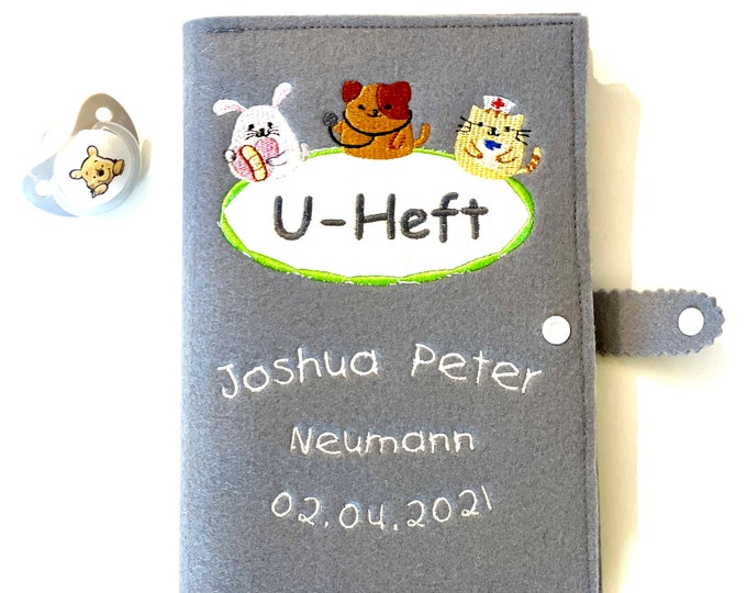 U-booklet cover made of felt, incl. vaccination certificate compartment, embroidered with name and date of birth