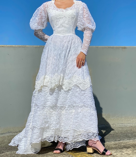 Vintage 70s White Lace Mutton Sleeve Wedding Gown.