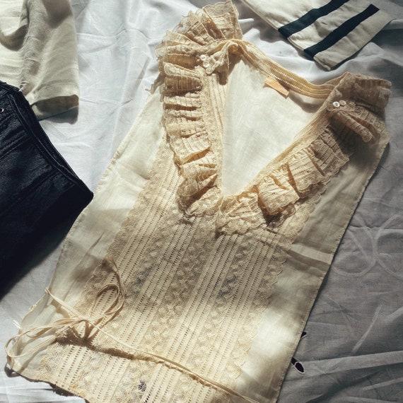 Antique 1920s cream lace corset cover.