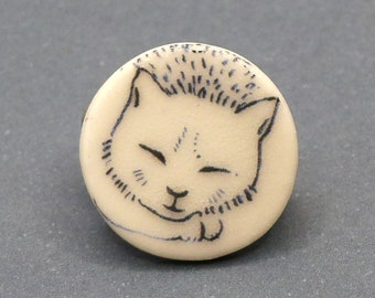small CAT brooch made of porcelain