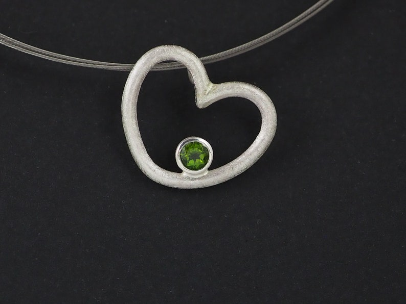 Silver pendant with set stone