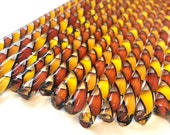 Orange, Red, and Black Glass Twist Cane 96 COE For Fusing, Blowing, Torch work, or Mosaic