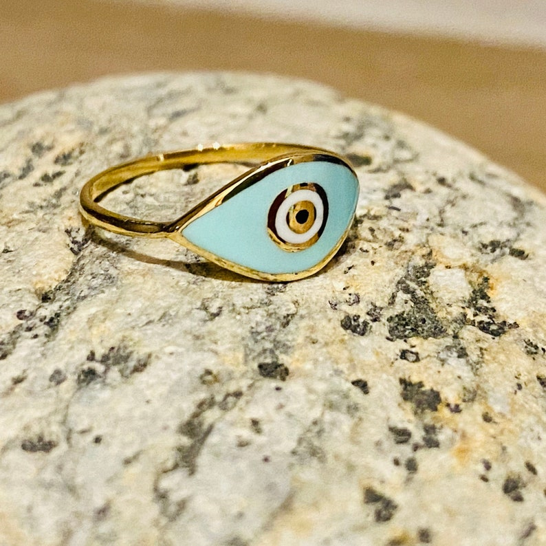 14k yellow gold ring with enamel eye design summer jewelry gift. Elegant light blue smalti on a solid gold band with protective properties