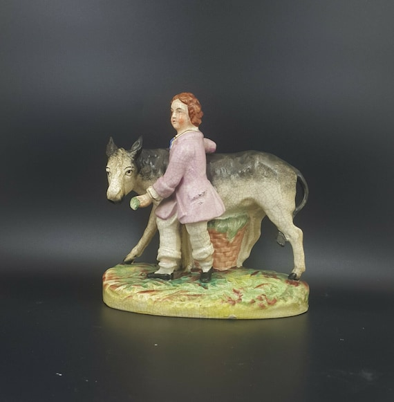 Staffordshire Figurine Man Cleaning Donkey