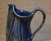 Wheel-thrown and Hand-altered Ceramic Clay Water Pitcher Beverage Container in Blue with Carved Leaf Pattern Details, Handle, and Pour Spout