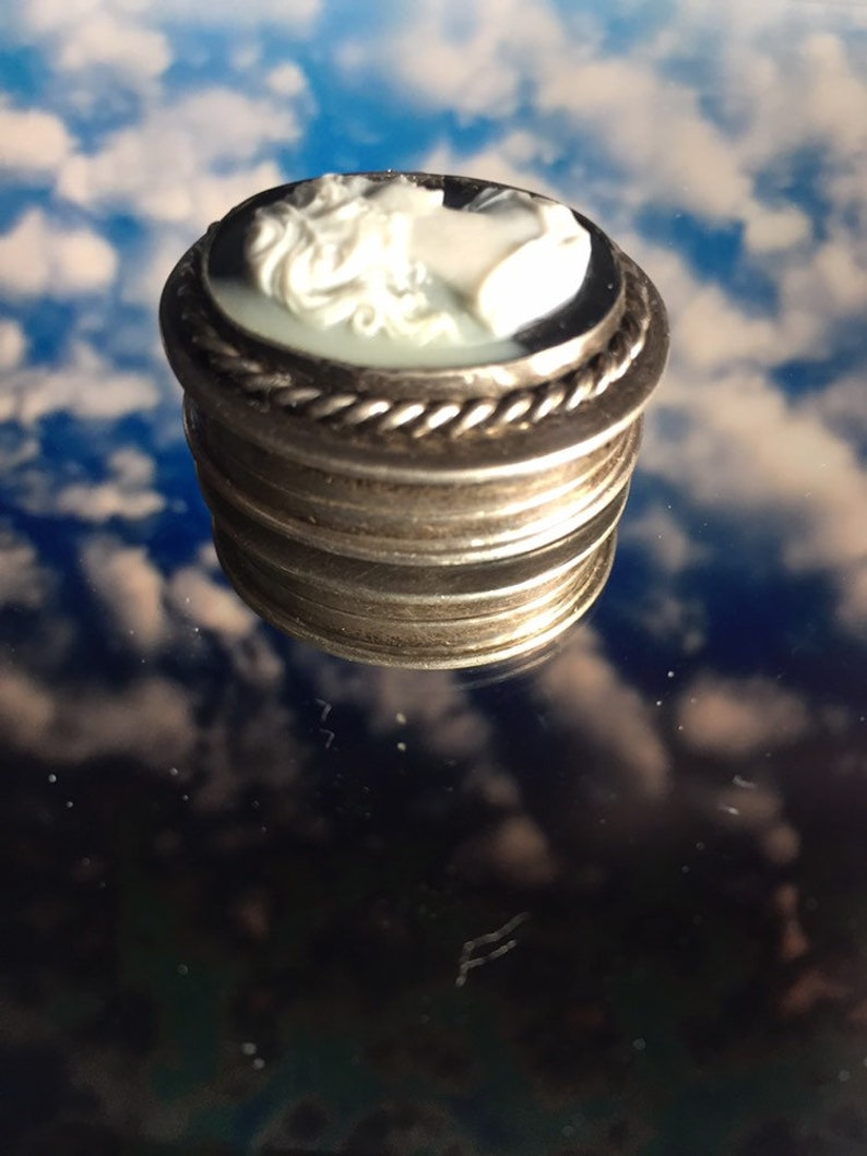 Unusual antique sterling silver 925 pill box with cameo black and white top.