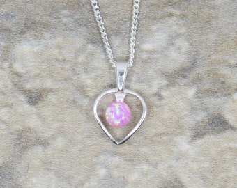 Handmade small pink opal heart pendant set in sterling silver