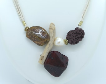 """""""Wild and refined composition"""" necklace in amber, lava stone, driftwood, baroque freshwater pearl"""