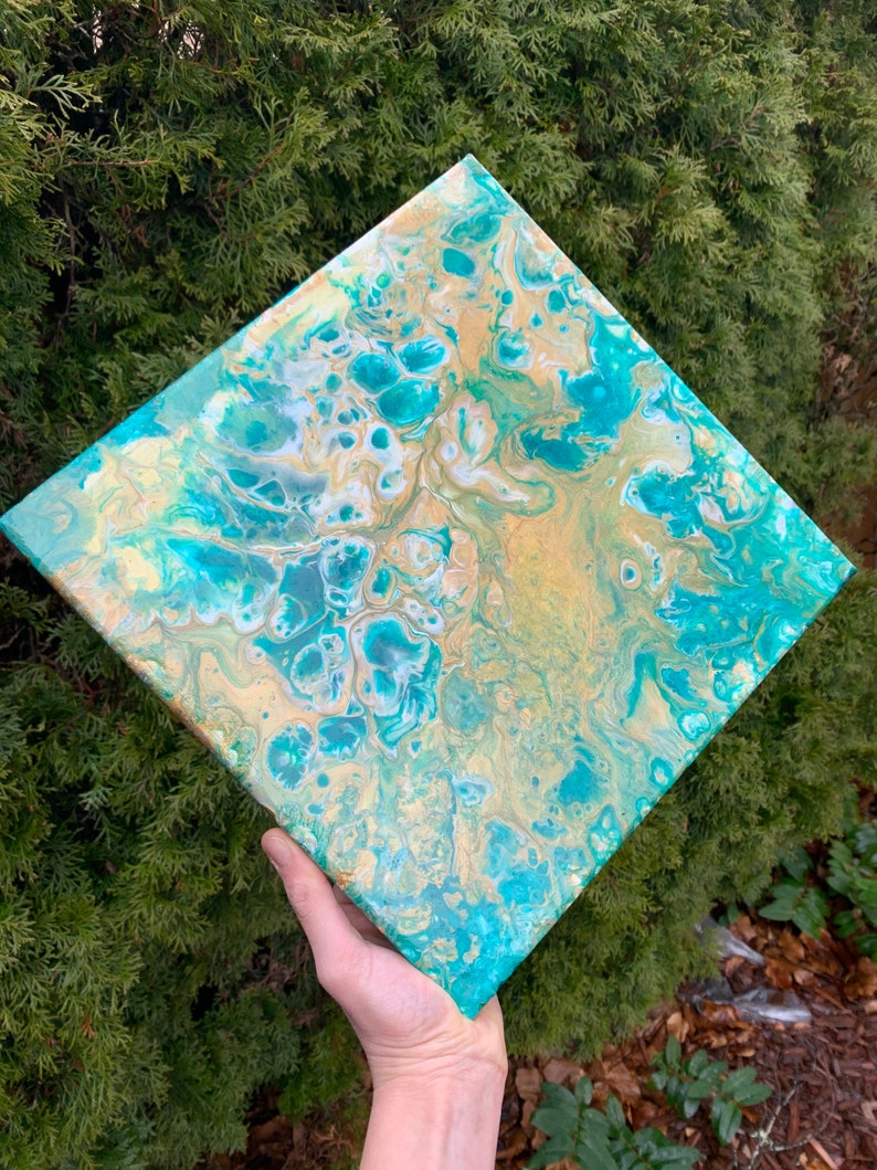 12x12\u201d green white and gold shimmery acrylic pour on canvas with lots of cells