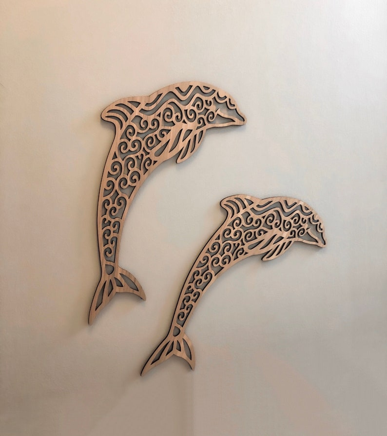 Intricately Cut Wooden Dolphins