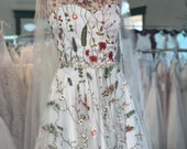 One of a kind flower embroidered tea-length gown.