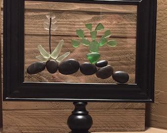 "Sea Glass Cactus Sun Catcher , 9"" x 10"" Black Frame on a pedestal."