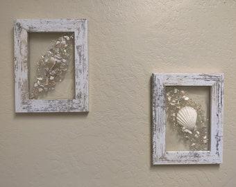 """Pair of white Ocean Sea Shell's in Resin. 7"""" x 9""""  White Wood Framed Art"""