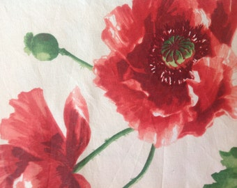 Heavy cotton. 86 ins x 101 ins wide.( 218 x 256 cms.)Large red poppies on cream. For projects - , curtains, cushions, bags and more.