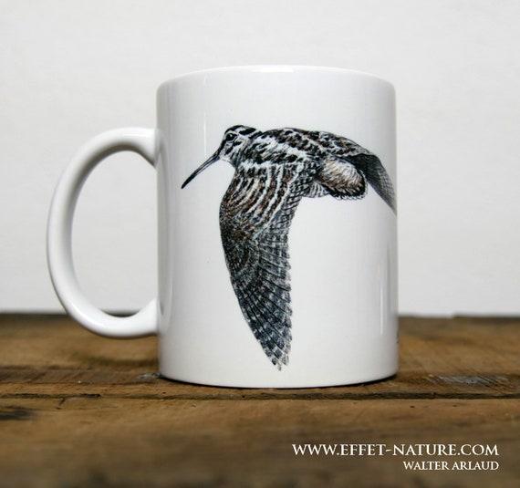 White ceramic mug illustration color flying woodcock signed by artist Walter Arlaud