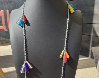 Twisted knit necklace necklace, trimmed with small multicolored cones