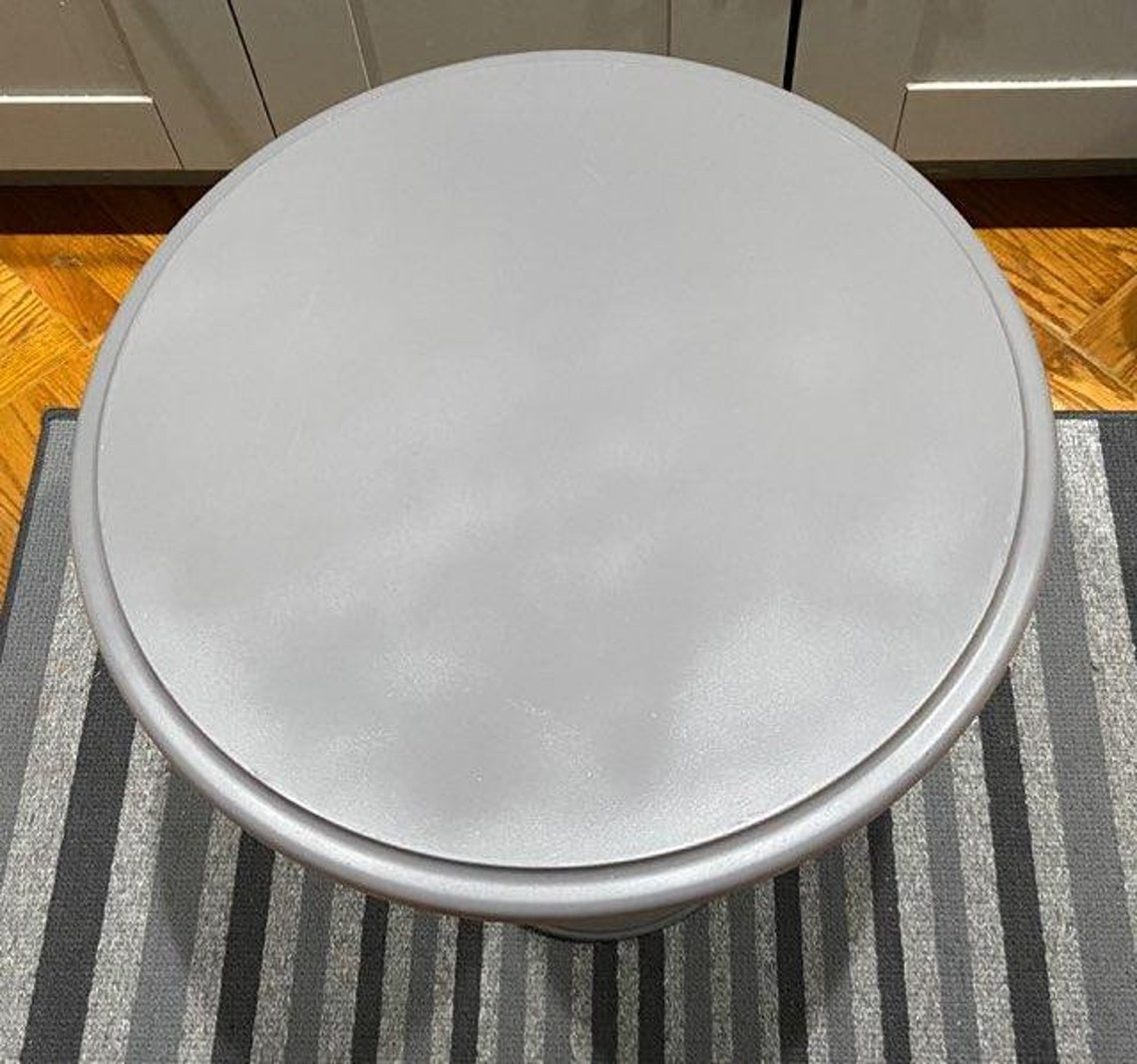 This Timeless Marble Round TableTop with Very Ornate Cherub Base can be used as a side table or night stand.