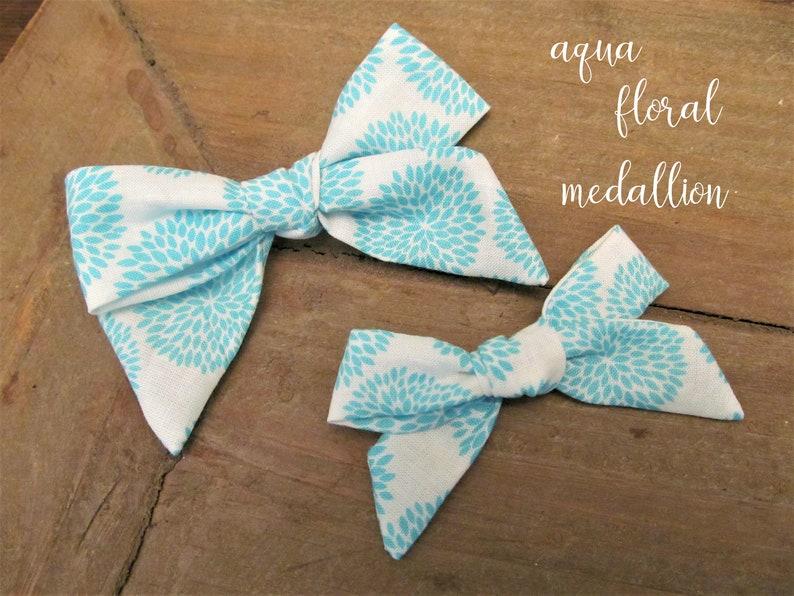 Aqua floral medallion bow headband  clip