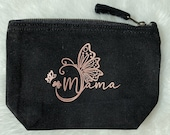 Cosmetic pomade with butterfly and mom lettering