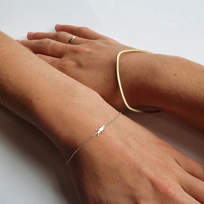 Delicate trace chain bracelet with tiny hand cut ant