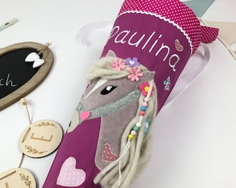 School bag/ sugar bag with name and horse, flowers in mane, for schooling for girls, made of fabric in purple and pink, with pillow