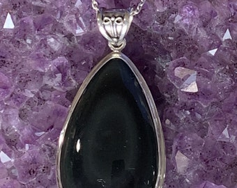Mastering The Darkness That Lives Within Each Of Us in copper Rainbow Obsidian gemstone pendant with Labradorite and Nuummite