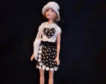 Skirt, t-shirt, belt, bikini, bag, beats, hairband, hat, shoes and a beach towel for Barbie