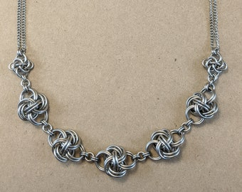 Sterling silver necklace with bronze accents,chainmaille necklace with mobius knot and rosetta chain