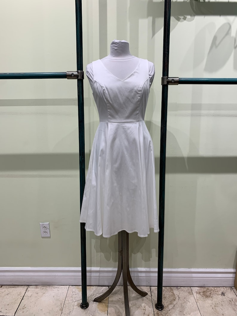 Eva Rose Solid White V-Neck Fit and Flare Dress With Pockets