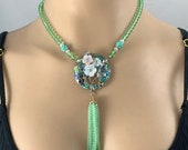 Striking boho chic light green beaded necklace set with abalone and beaded tassel drop