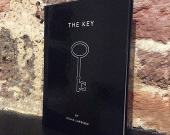 Coffee table book 'The Key' with thoughts and poetry by Jonas Larsson. All writings accompanied by black & white photos. Size A5