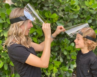 Protective face shields made in USA. Thick visor,  lay flat design, flip up, ultra-clear, comfortable to wear. Ideal for kids over 9 too.