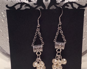 Hanging earrings . All delicate and sparkling looks.
