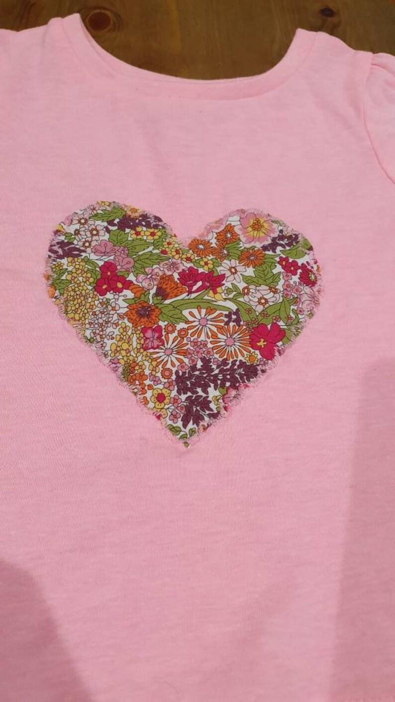 Appliqued pink heart T shirt