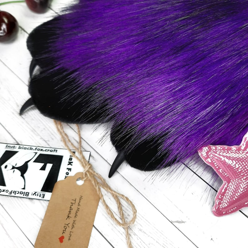 hand paws bright purple fursuit paws with black toes.fur paws are soft fluffy animal paws of different colors with claws Fursuit particles