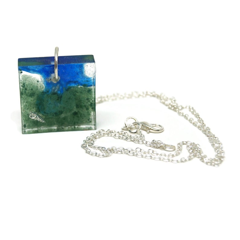 Blue and green square medallion Blue and green resin medallion with silver shell inlay