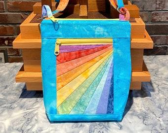 "Julicita Rainbow Crossbody Bag ""Vertical Light Sky"" in sky blue with a rainbow art deco accent panel"