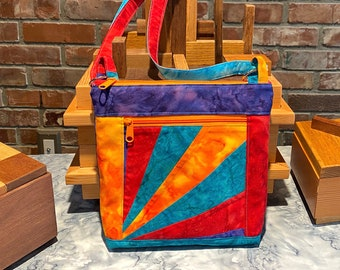 """Julicita Rainbow Crossbody Bag """"Sunrise"""" in deep purple, orange, red, and turquoise with radial array accent panel"""