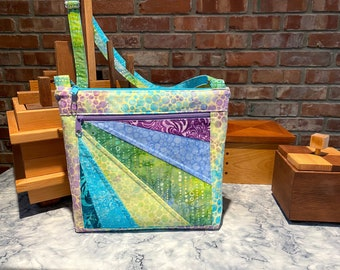 """Julicita Rainbow Crossbody Bag """"Bubbly"""" in pastel yellows, greens, blues and purples with radial array accent panel"""