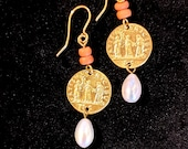 Handcrafted earrings in gold wet brass.  Pendant depicting the Parche, with corals and pearls